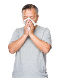 Mature man sneeze Stock Photo