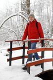 Man in a snowy park. Mature man in a snowy park Stock Photo
