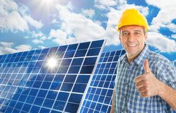 Mature man with solar panel. Mature Man With Photovoltaic Solar Panel Showing Thumb Up Royalty Free Stock Photography