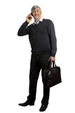 Mature man speaking on phone. Stock Image