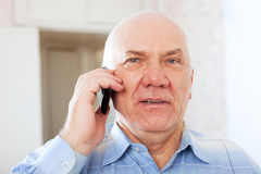 Mature man speaks by phone Stock Photo