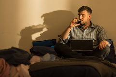Mature man spending evening alone Royalty Free Stock Photo