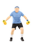 Mature man in sportswear exercising with dumbbells Royalty Free Stock Image