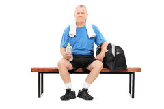 Mature man in sportswear sitting on bench Royalty Free Stock Photos