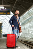 Mature man standing on train station platform with bag. Full body portrait of mature man standing on train station platform with bag Royalty Free Stock Photography