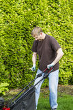 Mature man starting lawnmower Stock Photos