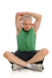 Mature Man Stretching. Mature man sitting and stretching isolated over white background Stock Images