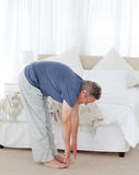 Mature man stretching Royalty Free Stock Photos