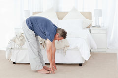 Mature man stretching Stock Photos