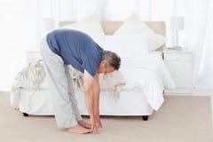 Mature man stretching Stock Photos