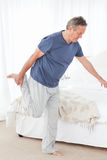 Mature man stretching Stock Photography