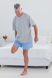 Mature man stretching his leg Stock Image