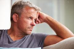 Mature Man Suffering From Depression At Home Stock Image