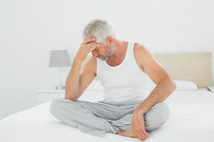Mature man suffering from headache in bed Royalty Free Stock Photography
