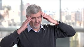 Mature man suffering from headache. Stressed senior man touching his temples because of strong head pain stock video