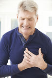 Mature Man Suffering Heart At Home Royalty Free Stock Images