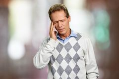 Mature man suffering from migraine. royalty free stock photos