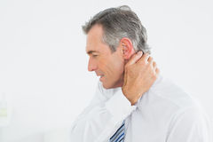Mature man suffering from neck pain Royalty Free Stock Images