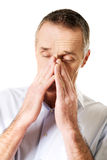 Mature man suffering from sinus pressure pain Stock Photography