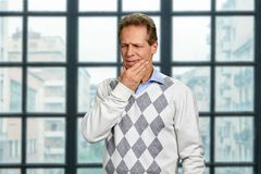Mature man suffering from toothache. royalty free stock photo
