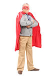 Mature man in superhero costume Stock Images