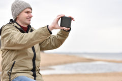 Mature man with tablet outdoors Royalty Free Stock Photography