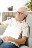 Mature man taking a nap in sofa at home. Handsome mature man taking a nap in sofa at home Royalty Free Stock Photos