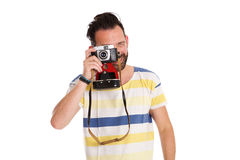 Mature man taking photo with old camera Royalty Free Stock Image