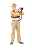 Mature man taking a picture with camera Royalty Free Stock Images