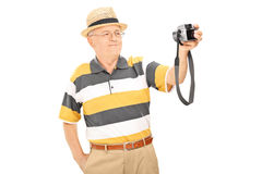 Mature man taking picture of himself with camera Stock Photos
