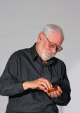 Mature man taking their drugs Stock Image