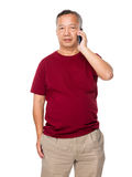 Mature man talk to cellphone Stock Photo