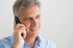 Mature Man Talking On Cellphone Royalty Free Stock Photography