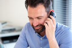Mature man talking on mobile phone Stock Photography
