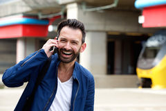 Mature man talking on mobile phone at railway station Stock Photos