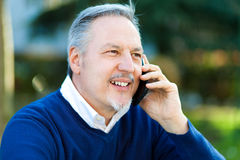 Mature man talking at the phone Royalty Free Stock Photo