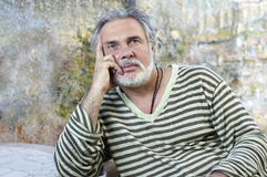 Mature man thinking. Portrait of a mature man thinking stock photos