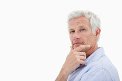 Mature man thinking Royalty Free Stock Image