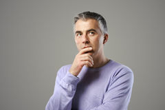 Mature man thinking. Portrait of casual man thinking and looking up Royalty Free Stock Photos