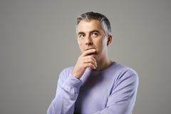 Mature man thinking Royalty Free Stock Photos
