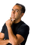Mature man thinking in white Royalty Free Stock Photography