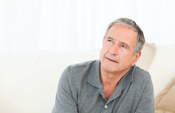 Mature man thoughtful Stock Image