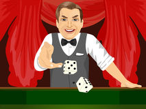 Mature man throwing dice in casino playing craps. Handsome mature man throwing dice in casino playing craps Royalty Free Stock Photography