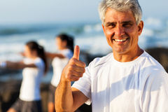 Mature man thumb up Stock Photography