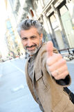 Mature man with thumb up Royalty Free Stock Images