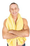 Mature man with a towel around neck. Smiling mature man with a towel around neck Stock Photos