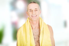 Mature man with a towel around neck. Smiling mature man with a towel around neck Stock Images