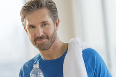 Mature Man With Towel On Shoulder. Portrait of fit mature man with towel on shoulder at home Royalty Free Stock Images