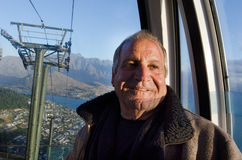 Mature man travel by aerial tramway Royalty Free Stock Photos