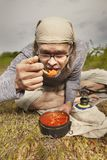Man on trip relaxing and cooking in nature royalty free stock images
